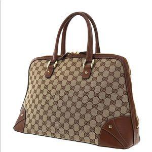 Authentic Gucci brown canvas satchel bag
